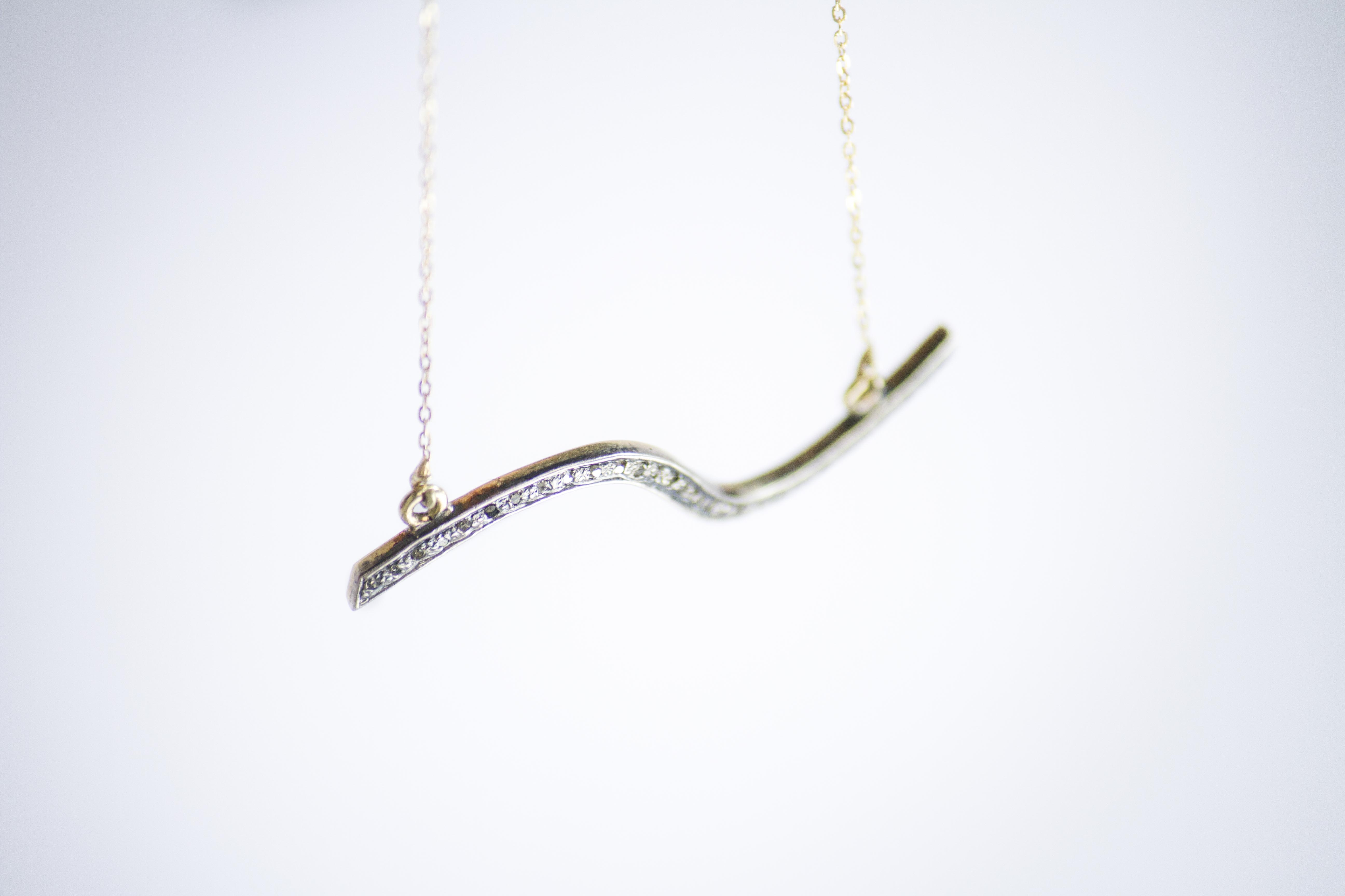 wave necklace Delicate pendant crafted with 14k yellow with diamond pave and a fine chain