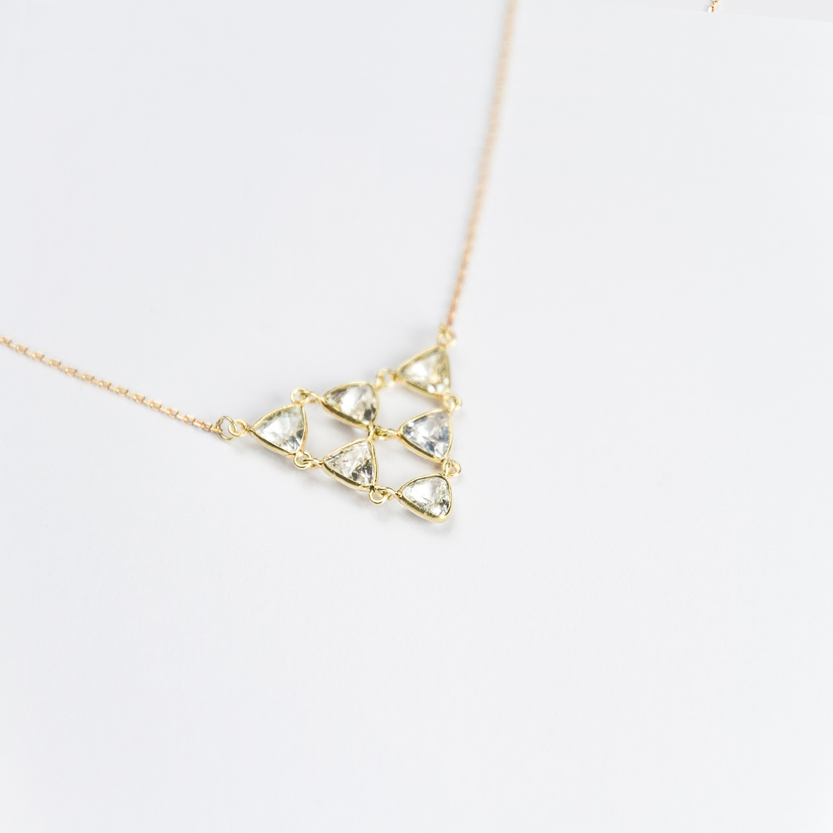 1. OONA_philo_ficha2_sapphire triangles cascade necklace