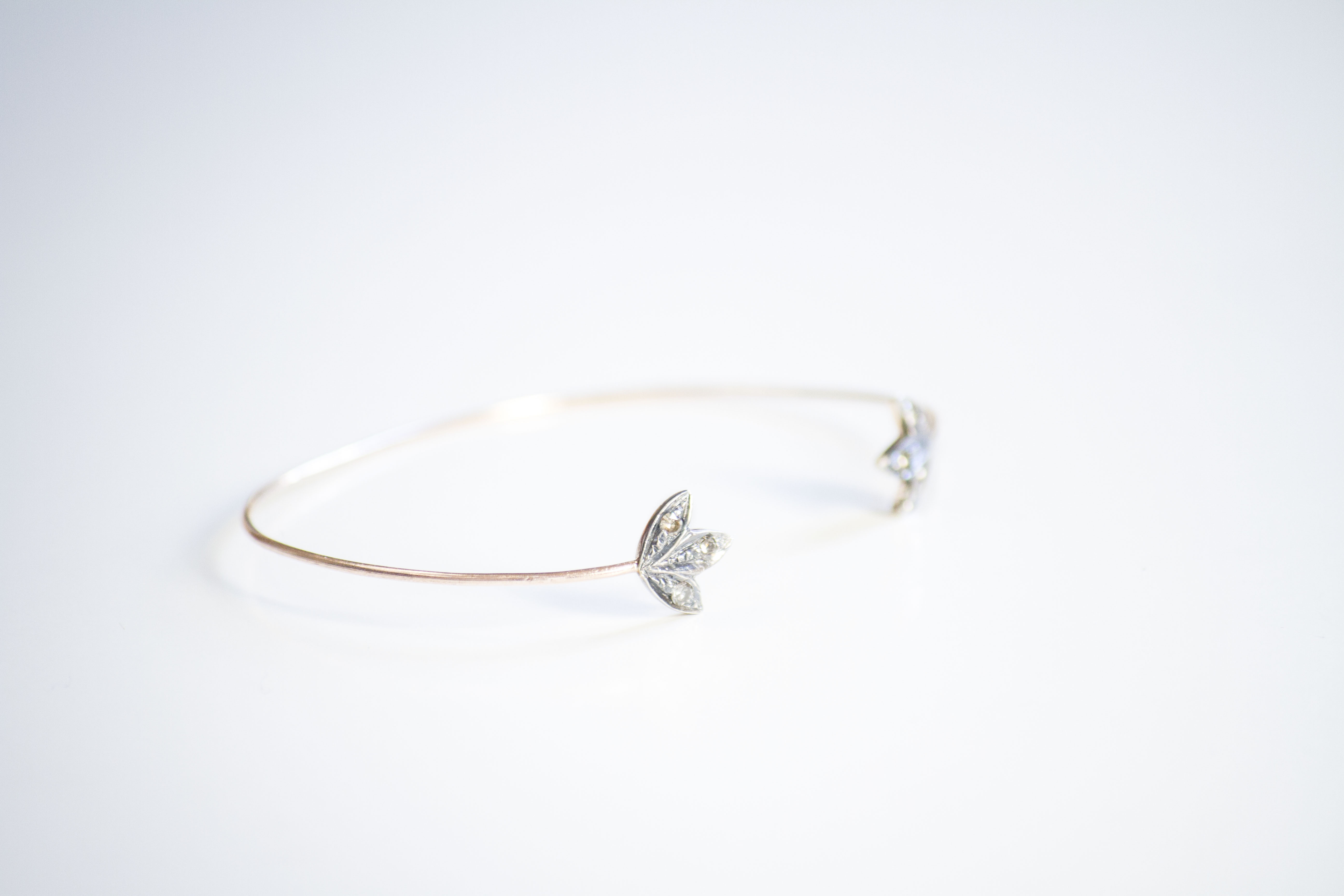 lotus bracelet Inspired by the Lotus flower, fine bangle in 14k rose gold with inset diamonds