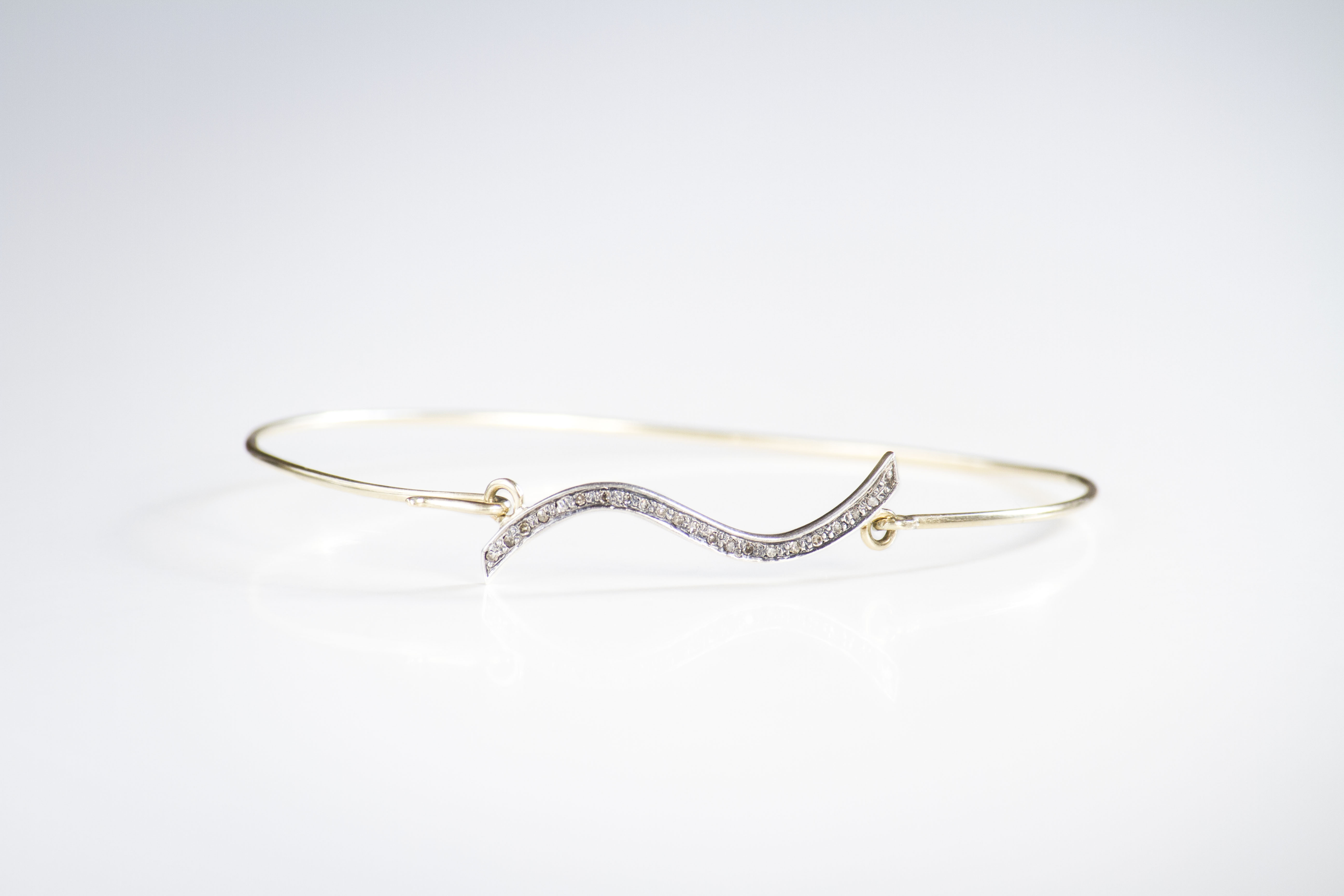 wave bracelet Delicate bangle in 14k yellow gold with diamond pave