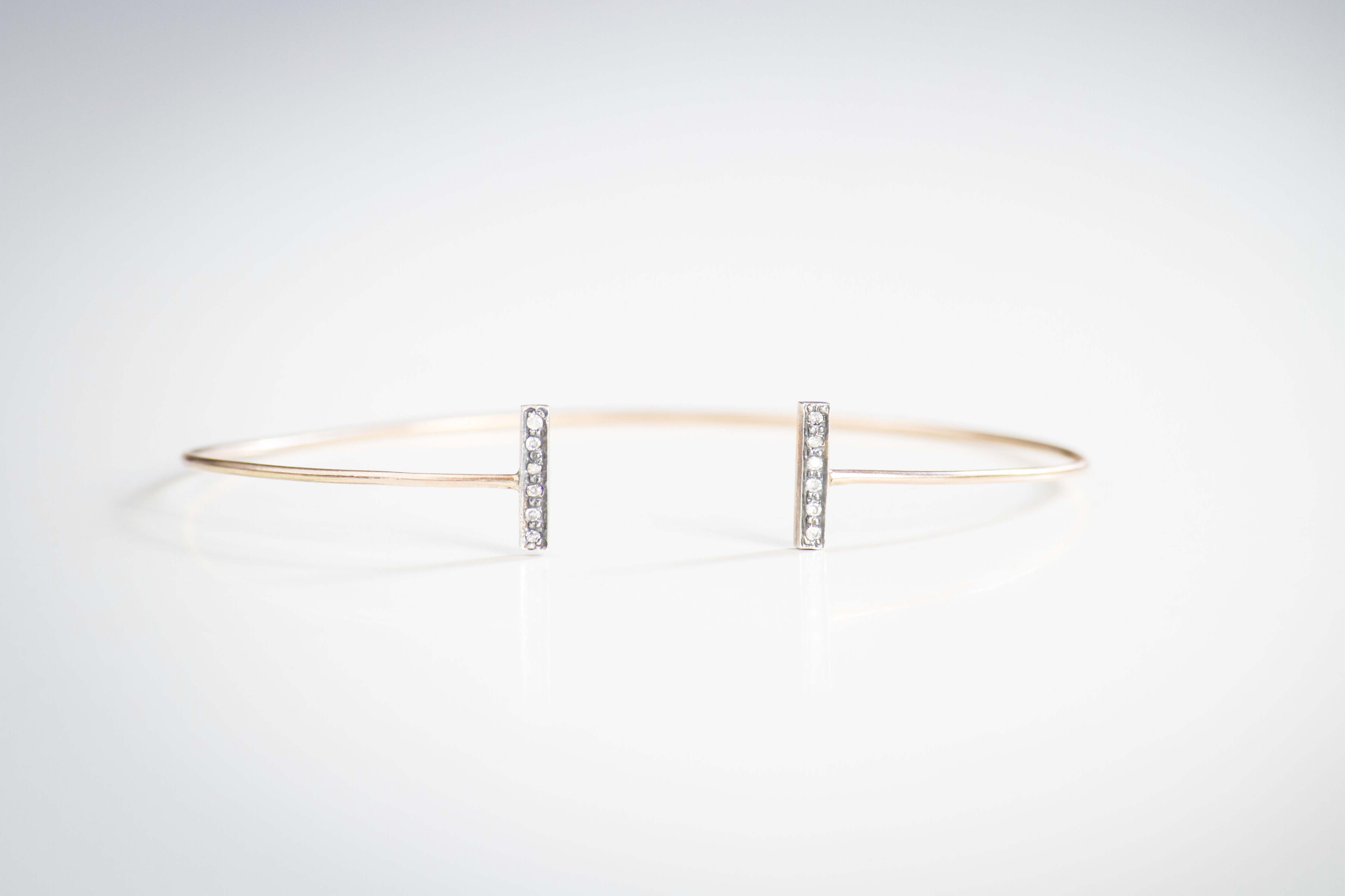 balance bracelet Pure lines for this bracelet crafted in 14k rose gold with diamond pave
