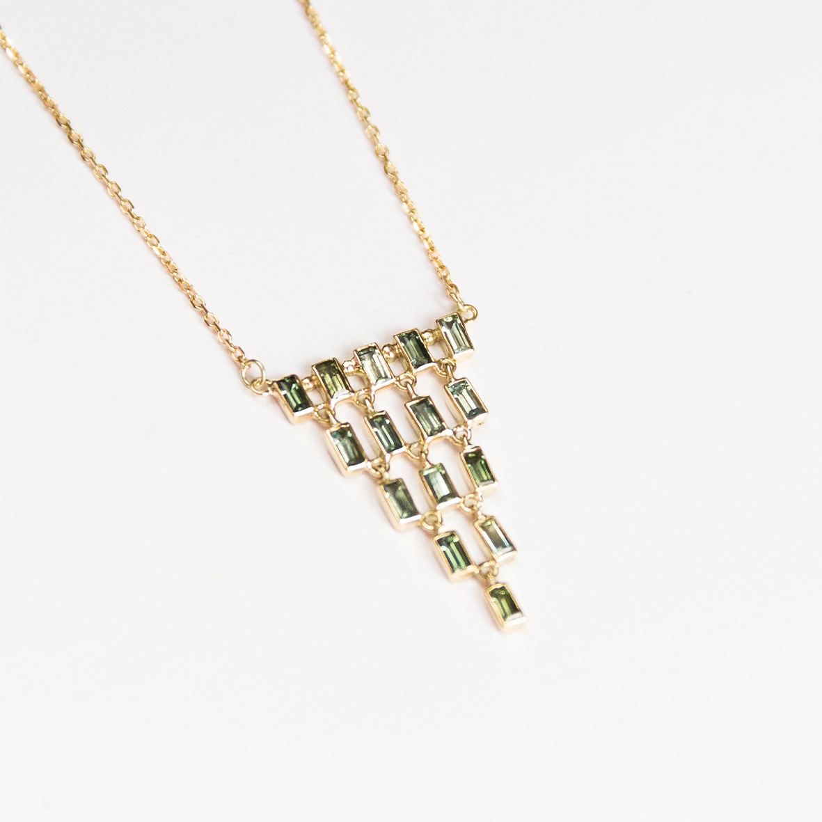 6. OONA_philo_principal_green baguette cascade necklace