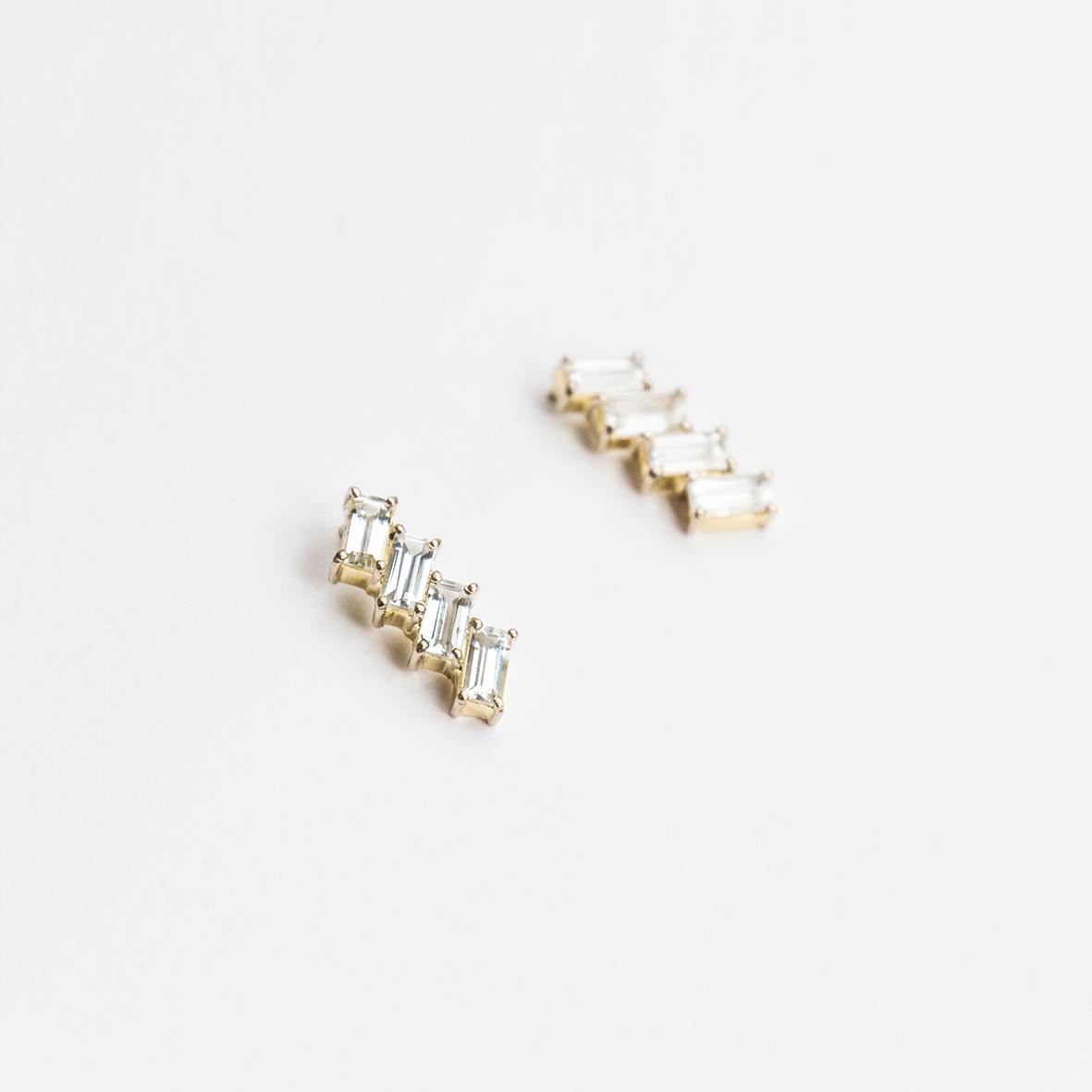 9. OONA_philo_principal_deco white sapphire earrings